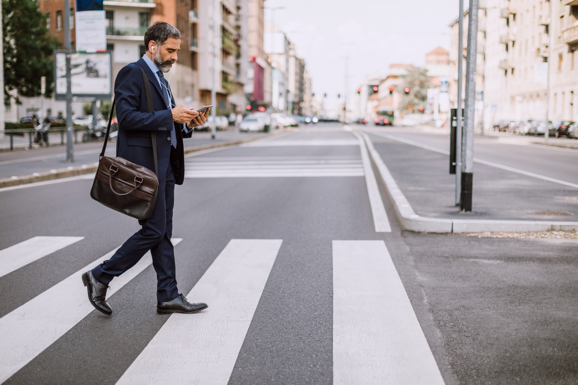 Man managing security on his app on his way to work