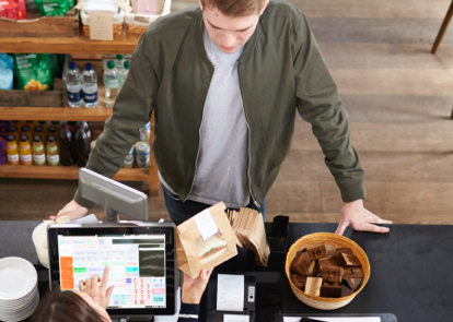 small business owner ringing up customer