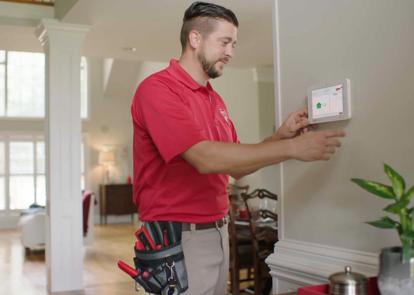 CPI technician installing a panel in a home