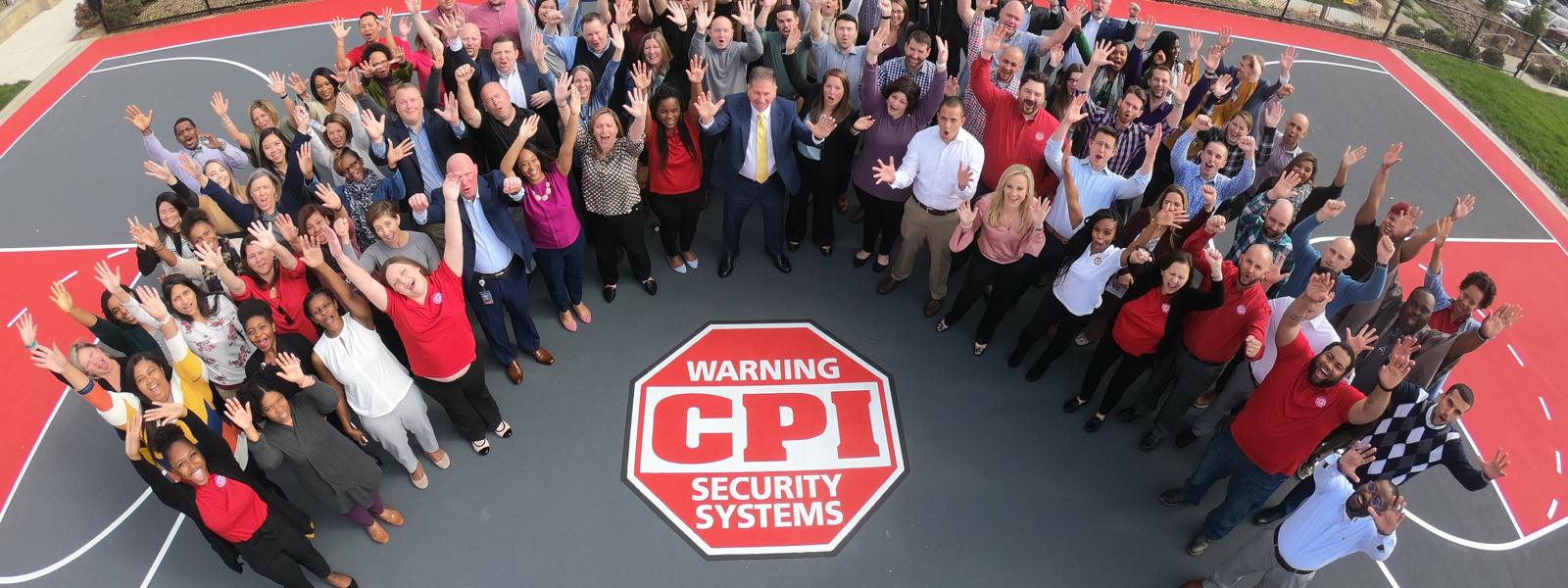 Full staff of CPI Security cheering