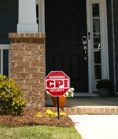 front porch of a house with a CPI logo yard sign in front