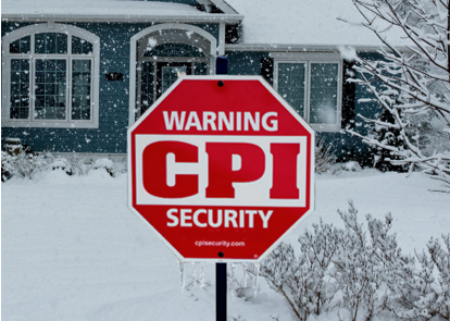 house with snow fall with a CPI yard sign in front