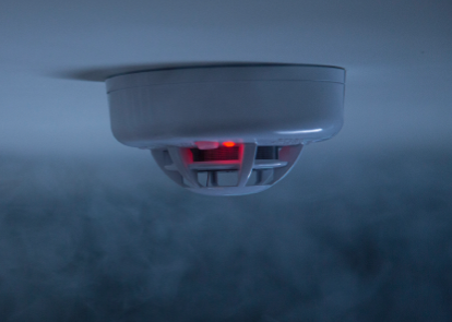 CPI smoke detector surrounded in smoke